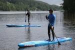 Stående paddling för att övervaka simmarna